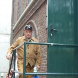 Oud mijnwerker in werkkledij