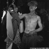 Jonge mijnwerker in badlokaal