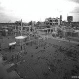 Opname gemaakt vanuit gondelwagen van de Lysinefabriek in aanbouw op het SBB