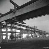 Avondfoto van de Rubberfabriek op het Polychemybedrijf