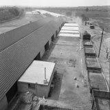 Blokkenloods en stapelterrein van de betonblokkenfabriek op de Staatsmijn Hendrik