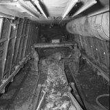 De Stoszschaufferlader in werking in het ondergronds bedrijf van de Staatsmijn Emma