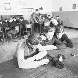 OVS-ers in het leslokaal tijdens de les mijnbouwkunde